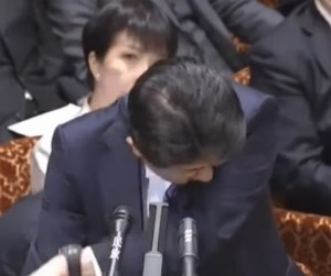 japanese prime minister cover cough with sleeve